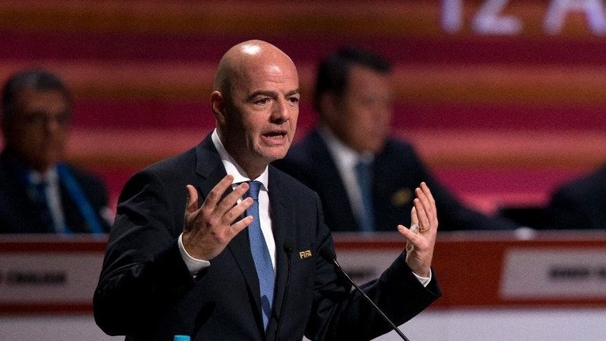FIFA President Gianni Infantino addresses delegates at the start of the 66th FIFA Congress, in Mexico City, Friday, May 13, 2016. (AP Photo/Rebecca Blackwell)