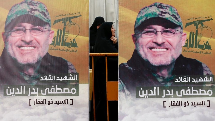 "Pictures of slain top commander Mustafa Badreddine, who was killed in Syria, hang during his funeral procession in a southern suburb of Beirut, Lebanon, Friday, May 13, 2016. Badreddine died in an explosion in Damascus, a death that is a major blow to the Shiite group, which has played a significant role in the conflict next door. Arabic reads, ""The martyr commander Mustafa Badreddine.""(AP Photo/Hassan Ammar)"