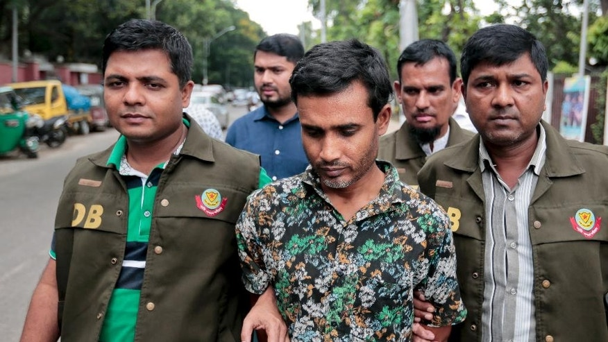 Members of Bangladesh Police Detective Branch (DB) escort a man, center, whom they have identified as Shariful Islam Shihab, a former member of the banned Islamic group Harkatul Jihad as they walk him in front of the media in Dhaka, Bangladesh, Sunday, May 15, 2016. Police said Sunday that they have arrested Shihab, a suspected Muslim militant for his alleged involvement in the killing last month of a gay rights activist and his friend in the capital. (AP Photo)