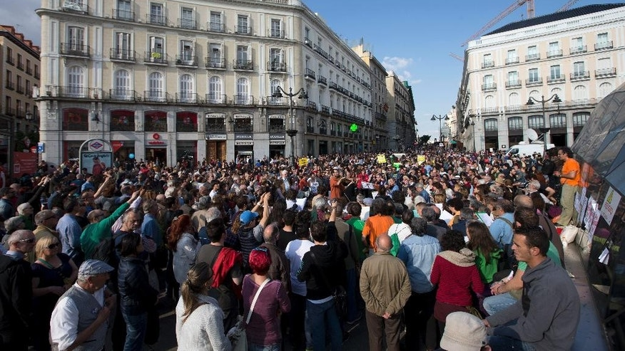 Musicians play as protesters pack the Puerta del Sol plaza in central Madrid, Sunday, May 15, 2016. The demonstration is to mark the fifth anniversary of a protest movement that led to the creation of Podemos, now Spain's third most-popular political party. (AP Photo/Paul White)