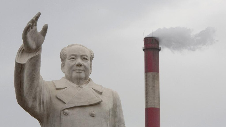 In this photo taken Monday, May 2, 2016, an enormous statue of Mao Zedong looms over the No. 1 Tractor Factory in Luoyang in central China's Henan province. Fifty years after Mao unleashed the decade-long Cultural Revolution to reassert his authority and revive his radical communist agenda, the spirit of modern China's founder still exerts a powerful pull. Millions of people were persecuted, publicly humiliated, beaten or killed during the upheaval, as zealous factionalism metastasized countrywide, tearing apart Chinese society at a most basic level. (AP Photo/Ng Han Guan)