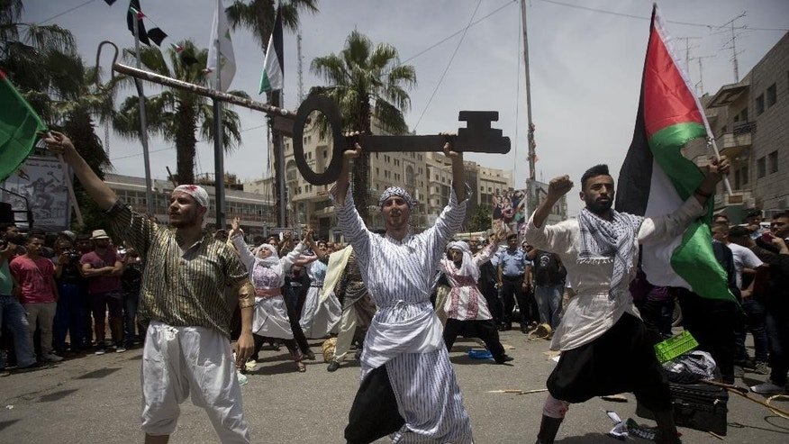 "Palestinians act in a play enacting ""Nakba"" or Catastrophe day in the West Bank city of Ramallah, Sunday, May 15, 2016. Palestinians marked the 68th anniversary of their displacement following the Israeli declaration of independence in 1968. (AP Photo/Majdi Mohammed)"