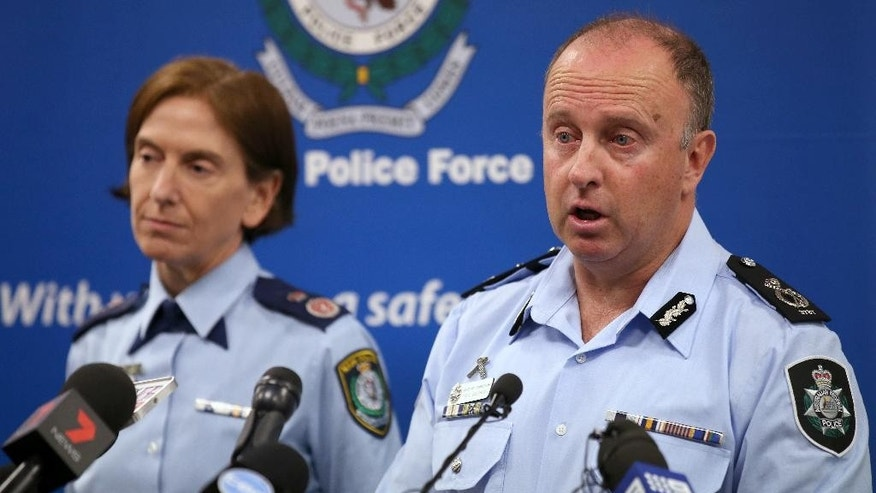 Australian Federal Police Acting Deputy Commissioner Neil Gaughan, right, announces that a teenager has been arrested amid allegations he had been planning to launch a terrorist attack in Sydney, Tuesday, May 17, 2016, while New South Wales Deputy Commissioner Catherine Burn listens. The Australian Federal Police said that the 18-year-old would be charged with planning a terrorist attack and preparing to enter a foreign country to engage in hostile activities. (AP Photo/Rick Rycroft)