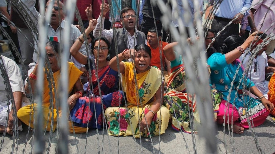 Supporters of Nepal's minority ethnic group chant slogans against the government during a protest outside the prime minister's residence in Kathmandu, Nepal, Tuesday, May 17, 2016. A British national has been detained in Nepal for questioning about his involvement in anti-government protests by ethnic minority groups, a government official said Tuesday. (AP Photo/Niranjan Shrestha)