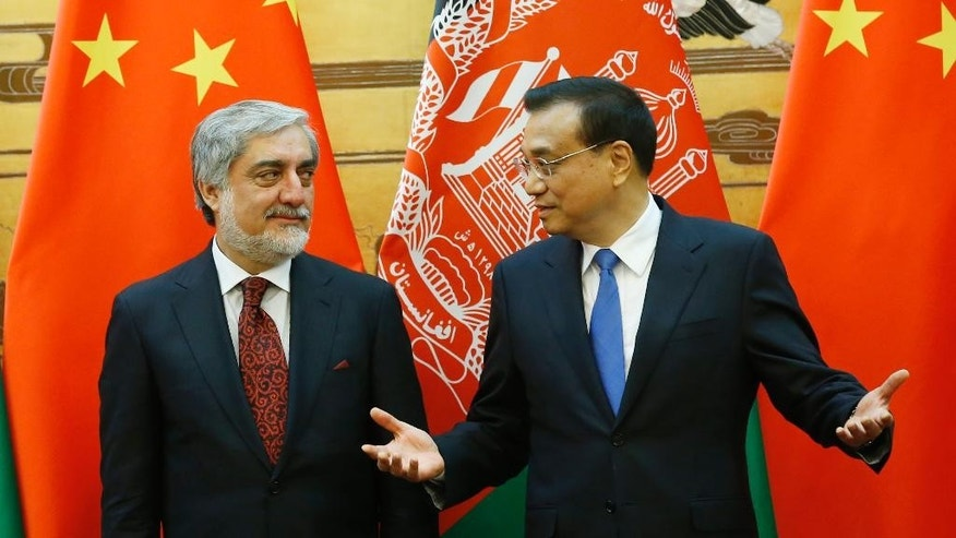 China Premier Li Keqiang, right, talks with Afghanistan Chief Executive Officer Abdullah Abdullah at a signing ceremony at the Great Hall of the People in Beijing, China, May 16, 2016. (Kim Kyung-Hoon, Pool Photo via AP)