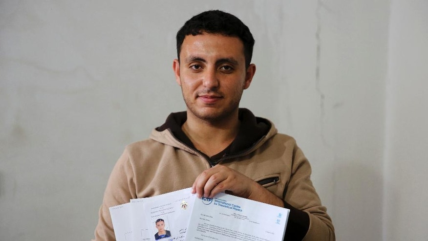 In this Tuesday, May 10, 2016 photo, Mohammed Al-Hissi, 25, poses for a photo while holding scholarship documents of his Master's program in physics at the University of Triesta in Italy, at his family house in Gaza City. Gazans who have endured a border blockade by neighboring Egypt and Israel for almost a decade thought they were finally catching a break when Israel slightly eased restrictions on travel from the Hamas-ruled territory in recent months. But now Jordan appears to be emerging as an obstacle, routinely denying transit permits for Gazans and effectively preventing patients, university students and others with business abroad from leaving the coastal territory. (AP Photo/Adel Hana)