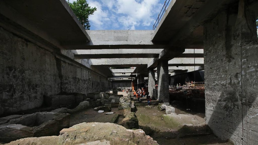 A view of ancient roman ruins discovered during work on a new underground line, in Rome, Monday, May 16, 2016. Work on the Metro C being built through the center of Rome has once again run into ancient roman ruins, this time the barracks for the Roman Praetorian guards dating back to the period of Emperor Hadrian, in the second century A.D. Officials say the barracks cover 900 square meters, and include a 100 meter hallway with 39 rooms.  (AP Photo/Alessandra Tarantino)