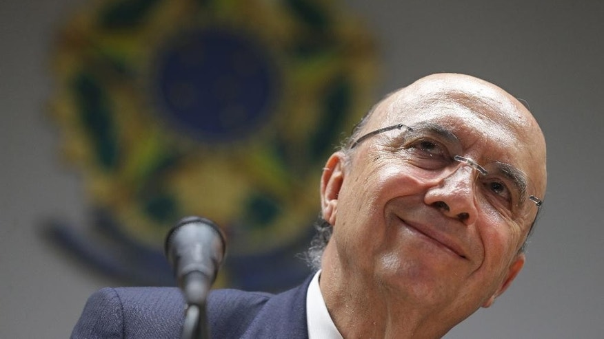 Brazil's Finance Minister Henrique Meirelles listens to a question during a press conference in Brasilia, Brazil, Tuesday, May 17, 2016. Meirelles became Brazil's economy boss last week after interim President Michel Temer took office. In a press conference in Brasilia, the new finance minister said that the country will gradually win the trust of investors with its appointments and policies. (AP Photo/Eraldo Peres)