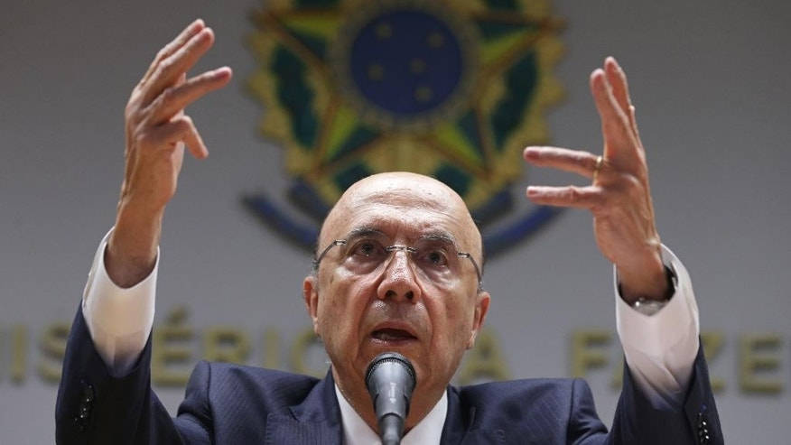 Brazil's Finance Minister Henrique Meirelles speaks during a press conference in Brasilia, Brazil, Tuesday, May 17, 2016. Meirelles became Brazil's economy boss last week after interim President Michel Temer took office. In a press conference in Brasilia, the new finance minister said that the country will gradually win the trust of investors with its appointments and policies. (AP Photo/Eraldo Peres)