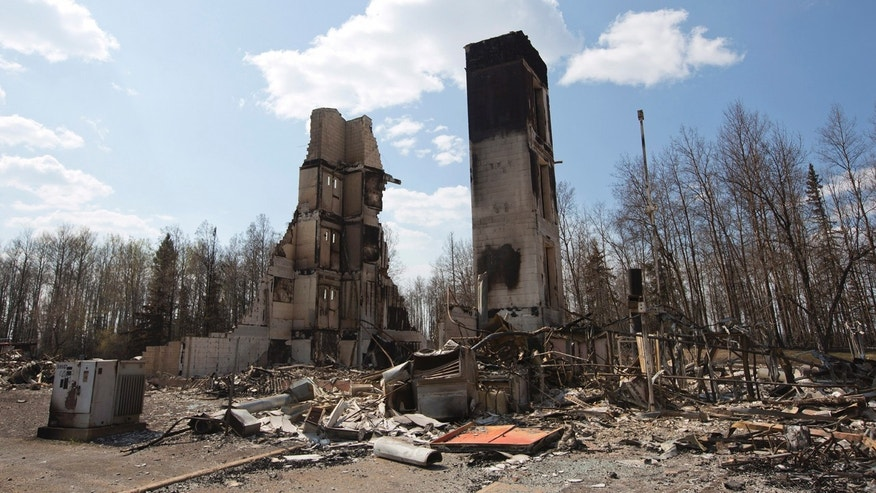 May 13, 2016: A burned building stands among charred rubble in the neighborhood of Abasand in wildfire-ravaged Fort McMurray, Alberta