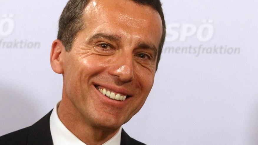 Designated new Austrian Chancellor Christian Kern smiles during a news conference after hearings with the Social Democrats, SPOE, in Vienna, Austria, Tuesday, May 17, 2016. Kern will be inaugurated later on Tuesday by Austria's President Heinz Fischer. (AP Photo/Ronald Zak)