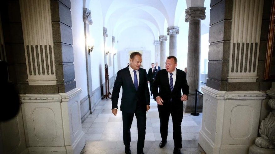 Danish Prime Minister Lars Lokke Rasmussen, right, and European Council President Donald Tusk walk together as they meet in Copenhagen Tuesday, May 17, 2016. The two had talks concerning the migrant crisis, the economical situation in Europe and the Russian/Ukrainian conflict. (Jens Dresling/POLFOTO via AP)  DENMARK OUT