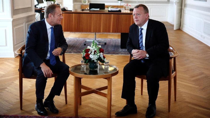 Danish Prime Minister Lars Lokke Rasmussen, right, and European Council President Donald Tusk talk during their meeting in Copenhagen Tuesday, May 17, 2016. The two had talks concerning the migrant crisis, the economical situation in Europe and the Russian/Ukrainian conflict. (Jens Dresling/POLFOTO via AP)  DENMARK OUT