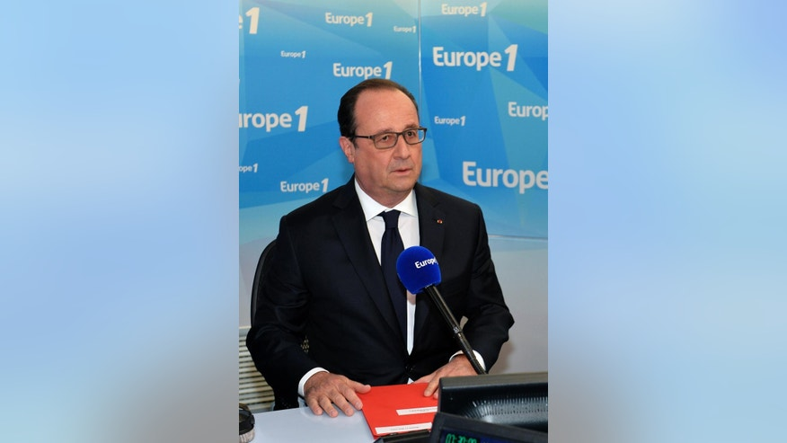 France's President Francois Hollande prepares to speak on France's Europe1 radio station, Tuesday, May 17, 2016 in Paris.  Hollande has promised he will lower taxes next year provided the state has sufficient leeway. (Miguel Medina, Pool via AP)