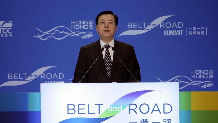 Chairman of the Standing Committee of China's National People's Congress, Zhang Dejiang gives speech at the Belt and Road Summit in Hong Kong, Wednesday, May 18, 2016. The top Beijing official is on a visit to the semiautonomous city, where tensions are rising over Chinese rule. (AP Photo/Kin Cheung)