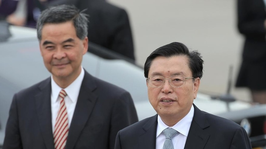 The chairman of the Standing Committee of China's National People's Congress, Zhang Dejiang, right, speaks to media next to Hong Kong's Chief Executive Leung Chun-ying after arriving at Hong Kong's airport, Tuesday, May 17, 2016. Hong Kong authorities have rolled out a massive security operation as they brace for protests during a top Beijing official's visit to the semiautonomous Chinese region. Thousands of police officers were deployed Tuesday as Zhang Dejiang began a three-day trip to Hong Kong. (AP Photo/Kin Cheung)