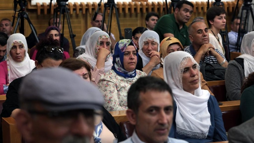 Supporters listen to Selahattin Demirtas, the leader of the pro-Kurdish Peoples' Democratic Party, the HDP, at the parliament in Ankara, Turkey, Tuesday, May 17, 2016. Turkey's parliament is discussing a controversial immunity amendment, which was drafted by the ruling party after President Recep Tayyip Erdogan accused the HDP of being an arm of the outlawed Kurdish rebel group. (AP Photo/Burhan Ozbilici)