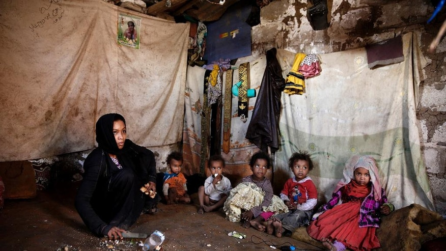 "In this April 25, 2016 photo, a family from a community who call themselves the ""Muhammasheen,"" or ""the Marginalized,"" who fled the city of Taiz due to the ongoing civil war, sit inside their home in a slum area of Sanaa, Yemen. They are Yemen's untouchables, a dark-skinned ethnic group that for centuries has been consigned to the bottom of Yemen's social scale, faced with discrimination and racism, and shunned by others. Vulnerable with no tribal protection, they have been hit particularly hard in Yemen's civil war. (AP Photo/Hani Mohammed)"