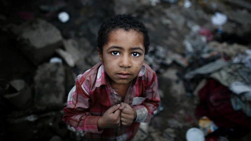"In this April 25, 2016 photo, a boy from the community who call themselves the ""Muhammasheen,"" or ""the Marginalized,"" stands near his hut in a slum area of Sanaa, Yemen. They are Yemen's untouchables, a dark-skinned ethnic group that for centuries has been consigned to the bottom of Yemen's social scale, faced with discrimination and racism, and shunned by others. Vulnerable with no tribal protection, they have been hit particularly hard in Yemen's civil war. (AP Photo/Hani Mohammed)"