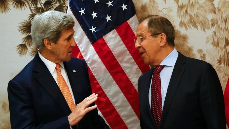 U.S. Secretary of State John Kerry and Russian Foreign Minister Sergey Lavrov, right, arrive for  a meeting in Vienna, Austria, Monday May 16, 2016.   (Leonhard Foeger/Pool Photo via AP)