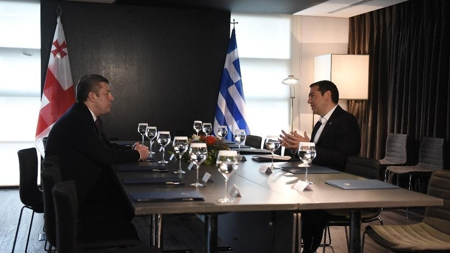 Greece's Prime Minister Alexis Tsipras, right, speaks with his Georgian Giorgi Kvirikashvili during their meeting in the northern Greek city of Thessaloniki, Tuesday, May 17, 2016. Tsipras and Kvirikashvili with other officials from Turkey, Bulgaria, Azerbaijan and Italy will participate in a ceremony of launch of the construction of Trans Adriatic Pipeline (TAP). (AP Photo/Giannis Papanikos)