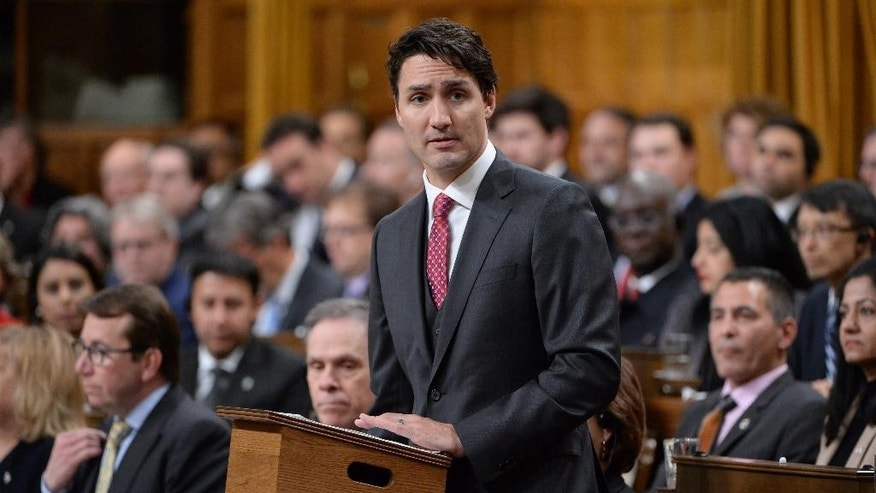 Prime Minister Justin Trudeau formally apologizes, Wednesday, May 18, 2016, in the House of Commons on Parliament Hill in Ottawa, for a 1914 Canadian government decision that barred most of the passengers of the Komagata Maru from entering the country. Canadian officials refused to allow the Indians in, even though they were British subjects just like every other Canadian of the time. The chartered vessel was carrying 376 Indian passengers, nearly all of them Sikhs, bound for what they thought would be a new life in Canada. (Adrian Wyld/The Canadian Press via AP) MANDATORY CREDIT