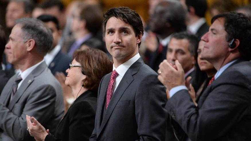 Prime Minister Justin Trudeau is applauded as he formally apologizes, Wednesday, May 18, 2016, in the House of Commons on Parliament Hill in Ottawa, for a 1914 Canadian government decision that barred most of the passengers of the Komagata Maru from entering the country. Canadian officials refused to allow the Indians in, even though they were British subjects just like every other Canadian of the time. The chartered vessel was carrying 376 Indian passengers, nearly all of them Sikhs, bound for what they thought would be a new life in Canada. (Adrian Wyld/The Canadian Press via AP) MANDATORY CREDIT
