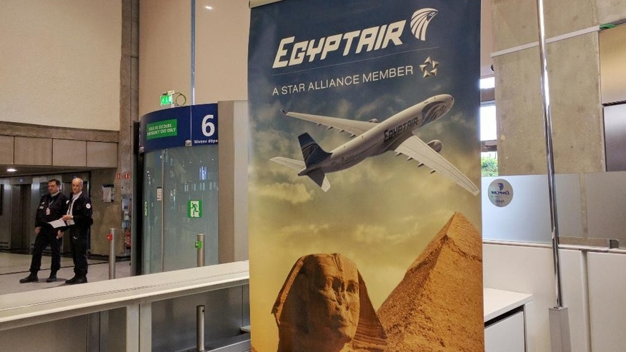 Airport security staff stand near the EgyptAir counter at Charles de Gaulle Airport outside of Paris, France, Thursday, May 19, 2016. EgyptAir said a flight from Paris to Cairo disappeared from radar early Thursday morning. (AP Photo/Raphael Satter)