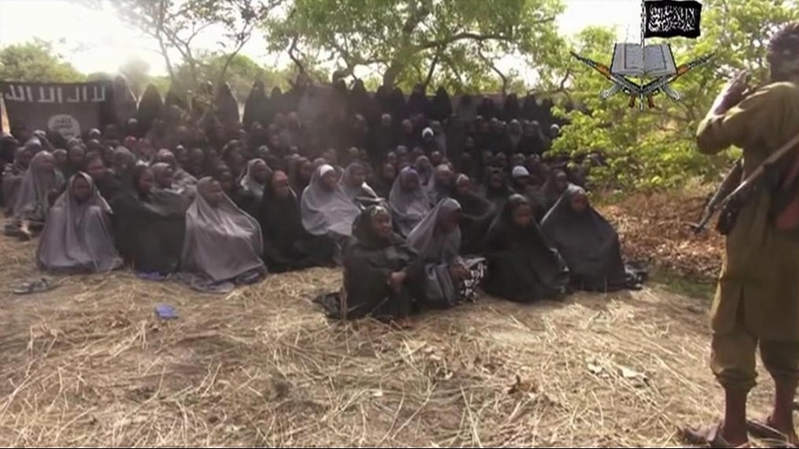 FILE - In this Monday, May. 12, 2014, file image taken from video by Nigeria's Boko Haram terrorist network, shows the alleged missing girls abducted from the northeastern town of Chibok.  Soldiers have found one of the girls kidnapped by Boko Haram from a boarding school in Chibok town, her uncle said Wednesday, May. 18, 2016 describing her as pregnant and traumatized but otherwise fine. Amina Ali Nkeki is the first of the 219 so-called Chibok girls to be freed since the mass abduction that grabbed attention around the world more than two years ago. (AP Photo/File)