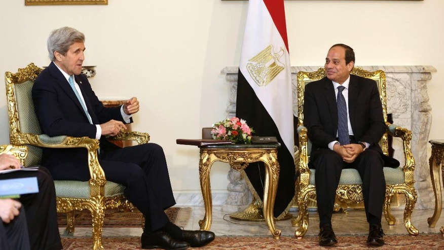 Egyptian President Abdel-Fattah el-Sissi, right, meets with U.S. Secretary of State John Kerry at the presidential palace in Cairo, Egypt, Wednesday, May 18, 2016. Kerry was holding talks Wednesday with Egyptian officials on the country's political situation and to explore Egypt's ideas for supporting a new Israeli-Palestinian peace bid. (AP Photo/Amr Nabil)