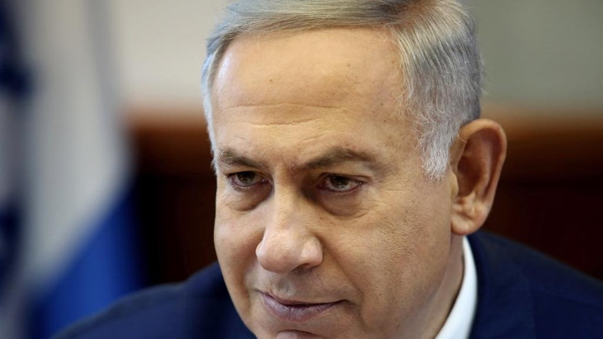 "FILE - In this Sunday, May 15, 2016, file photo, Israeli Prime Minister Benjamin Netanyahu heads the weekly cabinet meeting at the Prime Minister's office in Jerusalem. Egyptian President Abdel-Fattah el-Sissi said Tuesday that Egypt's relations with Israel, rooted in a landmark 1979 peace treaty, can only be ""warmer"" if his country's former enemy reached a settlement with the Palestinians and pledged to ""make every effort"" toward a solution. (Gali Tibbon/Pool Photo via AP, File)"