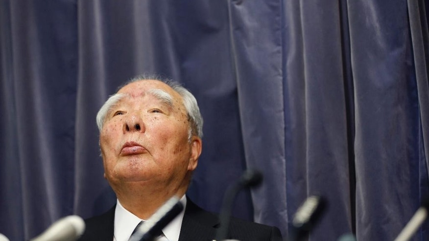 Suzuki Motor Corp. Chairman and Chief Executive Osamu Suzuki listens to a reporter's question during a press conference in Tokyo, Wednesday, May 18, 2016. Japanese automaker Suzuki apologized for improper road tests on some of its models but denies it illegally falsified mileage numbers. (AP Photo/Shizuo Kambayashi)