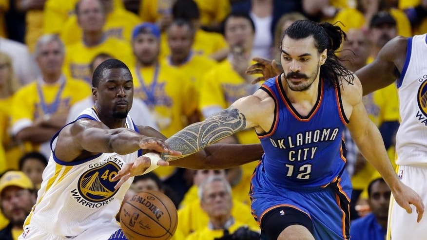 Oklahoma City Thunder's Steven Adams (12) fights for a loose ball against Golden State Warriors' Harrison Barnes (40) during the second half in Game 1 of the NBA basketball Western Conference finals Monday, May 16, 2016, in Oakland, Calif. Oklahoma City won 108-102. (AP Photo/Marcio Jose Sanchez)