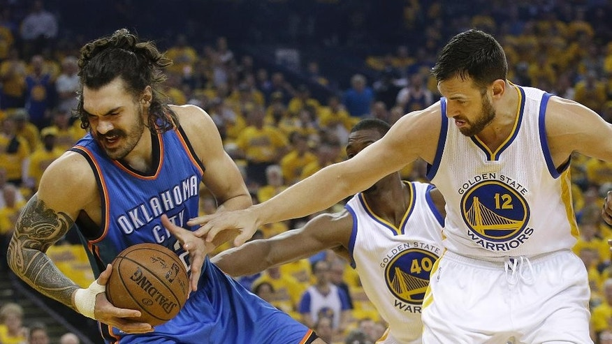 Oklahoma City Thunder center Steven Adams, left, is guarded by Golden State Warriors center Andrew Bogut during the first half of Game 1 of the NBA basketball Western Conference finals in Oakland, Calif., Monday, May 16, 2016. (AP Photo/Marcio Jose Sanchez)