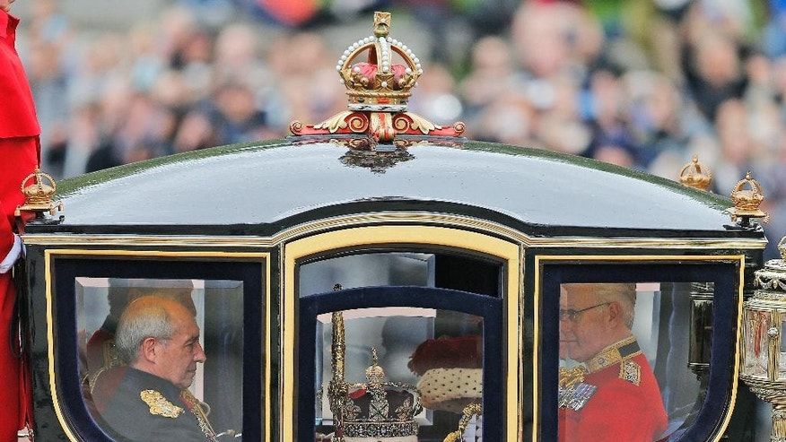The Imperial State Crown  travels in a carriage from Buckingham Palace towards the Houses of Parliament in London, Wednesday, May 18, 2016. Britain's Queen Elizabeth will wear the crown as she makes her speech to Parliament.(AP Photo/Frank Augstein)