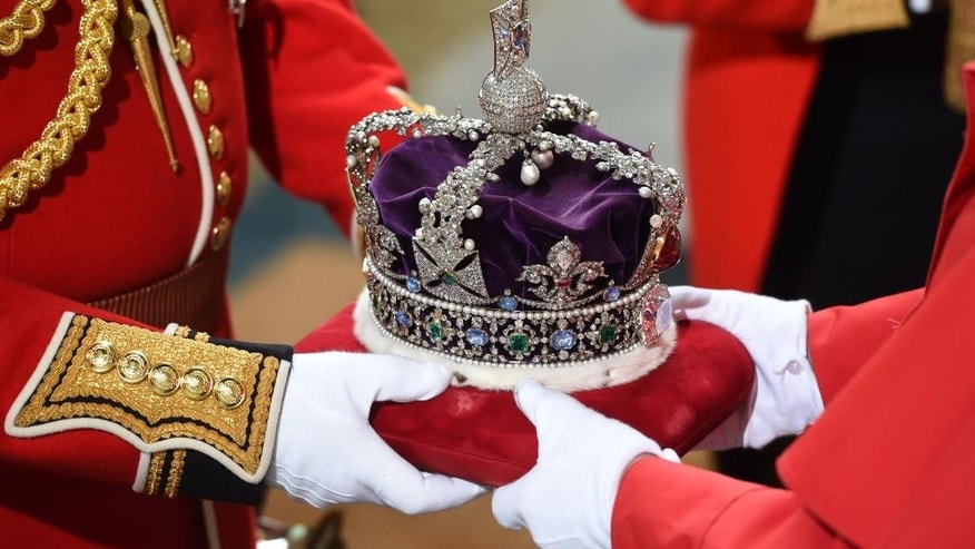 Britain's Queen Elizabeth's Imperial State Crown arrives at the Royal Gallery before the State Opening of Parliament in the House of Lords, at the Palace of Westminster in London, Wednesday May 18, 2016. The Queen will give a speech to parliament above the government's programme for the upcoming parliamentary year . (Eddie Mulholland/Pool via AP)