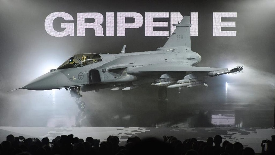 The new E version of the Swedish JAS 39 Gripen multi role fighter being rolled out at SAAB in Linkoping, Sweden, Wednesday, May 18, 2016. Swedish aircraft maker Saab has unveiled the latest version of its Gripen fighter jet. The E fighter is slightly bigger than previous versions, has a stronger engine and updated radar systems. It has been in development for about 10 years. The first test flight is expected later this year. (Anders Wiklund/TT via AP)  SWEDEN OUT