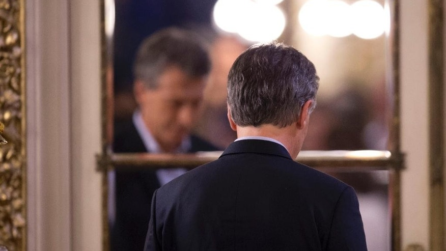 FILE - In this April 7, 2016, file photo, President Mauricio Macri leaves after making a statement at the government house in Buenos Aires, Argentina. Argentina's House of Deputies has given final congressional approval on Thursday, May 19, to a bill that would ban layoffs in the public and private sectors. The president has said he will veto it because it might scare off badly needed investment. (AP Photo/Natacha Pisarenko, File)
