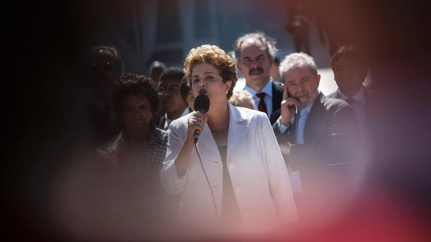 "FILE - In this Thursday, May 12, 2016 file photo, suspended Brazilian President Dilma Rousseff, framed between a crowd of supporters, speaks after leaving the Planalto presidential palace in Brasilia, Brazil. Hours after lawmakers voted to impeach Rousseff, Brazil's first female president blasted her enemies for making her ""the victim of a great injustice"" and promised a bruising fight to hold onto her mandate. Pictured right is former President Luiz Inacio Lula da Silva. (AP Photo/Felipe Dana, File)"