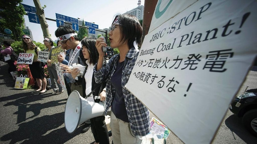A group of people protest against climate change and coal investments, ahead of the G7 Finance Ministers and Central Bank Governors' Meeting, in front of the Ministry of Finance in Tokyo, Thursday, May 19, 2016. The G7 Finance Ministers and Central Bank Governors' Meeting is held on May 20-21 in Sendai, northern Japan. (AP Photo/Eugene Hoshiko)