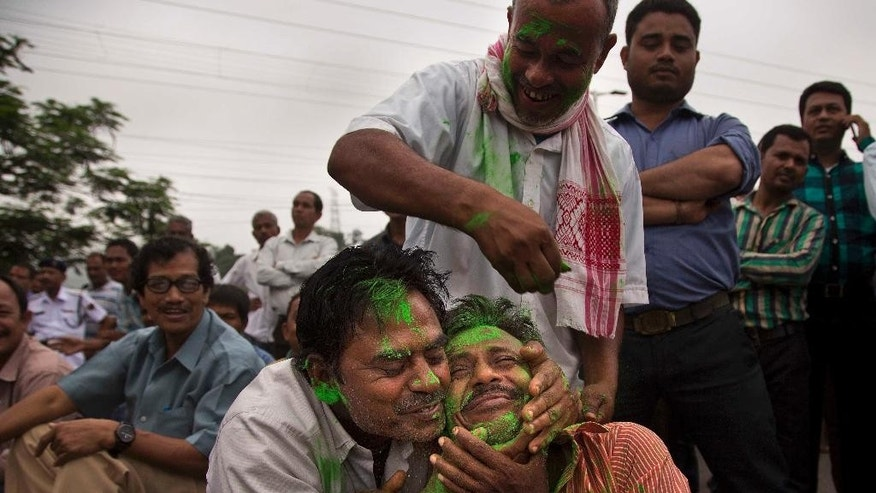 Bharatiya Janata Party, (BJP) supporters smeared colors after winning Assam state election in Gauhati, India, Thursday, May 19, 2016. India's ruling Hindu nationalist has made dramatic gains in elections in the eastern state of Assam but trails in four other states that went to polls earlier this month. Data from India's election commission on Thursday showed that Prime Minister Narendra Modi's Bharatiya Janata Party and its allies will form the government in Assam, which has been ruled by the opposition Congress party for 15 years.(AP Photo/ Anupam Nath)