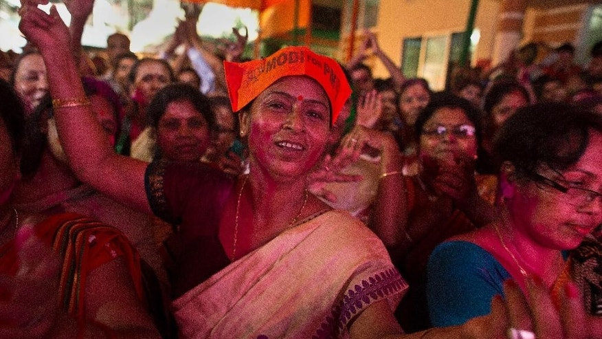 Bharatiya Janata Party, (BJP) supporters celebrate after winning Assam state election in Gauhati, India, Thursday, May 19, 2016. India's ruling Hindu nationalist has made dramatic gains in elections in the eastern state of Assam but trails in four other states that went to polls earlier this month. Data from India's election commission on Thursday showed that Prime Minister Narendra Modi's Bharatiya Janata Party and its allies will form the government in Assam, which has been ruled by the opposition Congress party for 15 years. (AP Photo/ Anupam Nath)