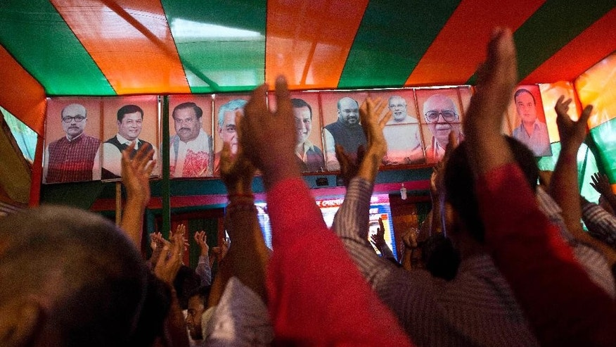 Bharatiya Janata Party (BJP) supporters celebrate in their head office after winning Assam state election in Gauhati, India, Thursday, May 19, 2016. India's ruling Hindu nationalist has made dramatic gains in elections in the eastern state of Assam but trails in four other states that went to polls earlier this month. Data from India's election commission on Thursday showed that Prime Minister Narendra Modi's BJP and its allies will form the government in Assam, which has been ruled by the opposition Congress party for 15 years. (AP Photo/ Anupam Nath)