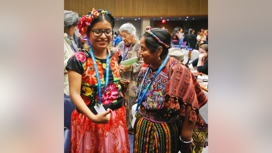 In this May 16, 2016 photo, Mexico's indigenous youth leader Dali Angel Perez, left, coordinator of the Commission for Indigenous Children and Youth of the Ciarena Organization for Indigenous Women, and Guatemala's indigenous leader Rosalina Tuyuc, right, founder of the National Association of Guatemalan Widows, confer during the 15th session of the U.N. Permanent Forum on Indigenous Issues at U.N. headquarters. Representatives from the most remote regions of the world cope with New York's bedlam and the U.N.'s bureaucracy as they attend a forum on indigenous issues. (AP Photo/Bebeto Matthews)