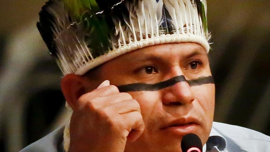 In this May 16, 2016 photo, Brazil's indigenous Guarani-Kaiowá leader Eliseu Lopes, speaks during the 15th session of the United Nations Permanent Forum on Indigenous Issues at U.N. headquarters. Representatives from the most remote regions of the world cope with New York's bedlam and the U.N.'s bureaucracy as they attend a forum on indigenous issues. (AP Photo/Bebeto Matthews)