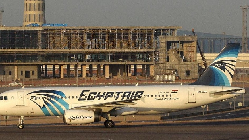 In this Dec. 10, 2014 image an EgyptAir Airbus A320 with the registration SU-GCC on the tarmac at Cairo airport. Egyptian aviation officials said on Thursday May 19, 2016 that an EgyptAir flight MS804 with the registration SU-GCC, travelling from Paris to Cairo with 66 passengers and crew on board has crashed. The officials say the search is now underway for the debris. (AirTeamImages via AP) MANDATORY CREDIT