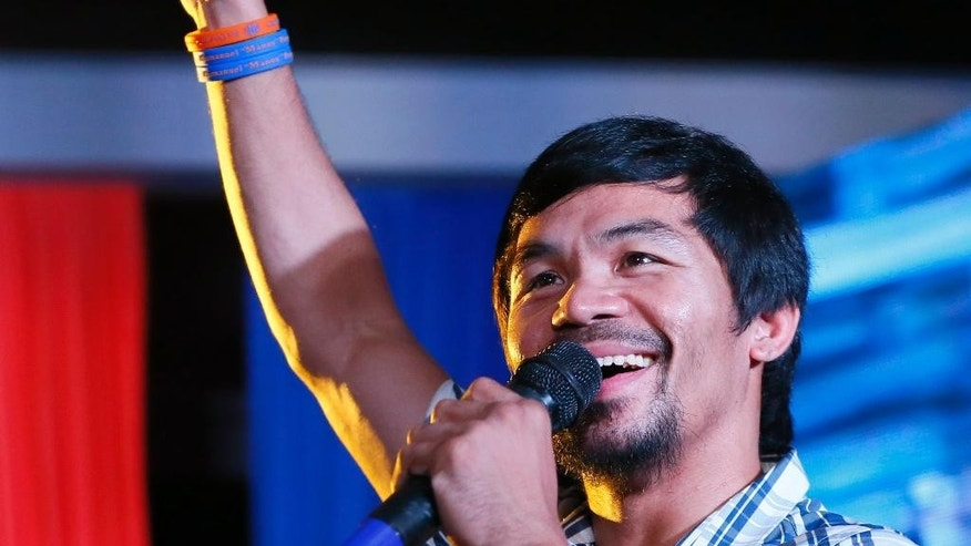 FILE - In this April 28, 2016, file photo, boxing star Manny Pacquiao addresses supporters as he campaigns for a seat in the Philippine Senate in San Pablo city, Laguna province, Philippines. Pacquiao was proclaimed Thursday, May 19, 2016, as one of the winners of Philippine Senate seats, bringing him closer to a possible crack at the presidency. (AP Photo/Bullit Marquez, File)