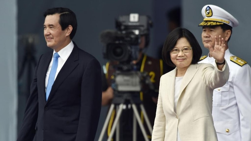 Taiwan's Tsai Ing-wen, right, waves beside incumbent President Ma Ying-jeou at the Presidential Office Building in Taipei, Taiwan, Friday, May 20, 2016.  Taiwan inaugurated Tsai as its first female president on Friday, returning the pro-independence Democratic Progressive Party to power amid new concerns over increasingly fractious relations with Beijing and a flagging economy.  (Minoru Iwasaki/Kyodo News via AP)  JAPAN OUT, CREDIT MANDATORY