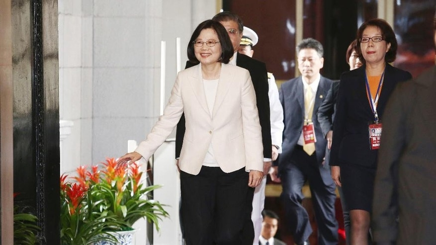Taiwan's new president Tsai Ing-wen arrives for the presidential inauguration ceremony at the Presidential Office, Friday , May 20, 2016, in Taipei, Taiwan. Taiwan inaugurated Tsai Ing-wen as its first female president on Friday, returning the pro-independence Democratic Progressive Party to power amid new concerns over increasingly fractious relations with Beijing and a flagging economy. (Taipei Photojournalist Association, Pool Photo via AP)