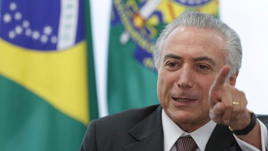 Brazil's acting President Michel Temer speaks during a meeting with trade unions, on the government's proposal for Social Security reform, at the Planalto Presidential Palace, in Brasilia, Brazil, Monday, May 16, 2016. Temer, Dilma Rousseff's two-time running-mate turned nemesis, immediately assumed power after her May 12 suspension and will remain while an impeachment trial takes place within the next six months. (AP Photo/Eraldo Peres)